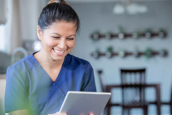 Nurse looking at iPad