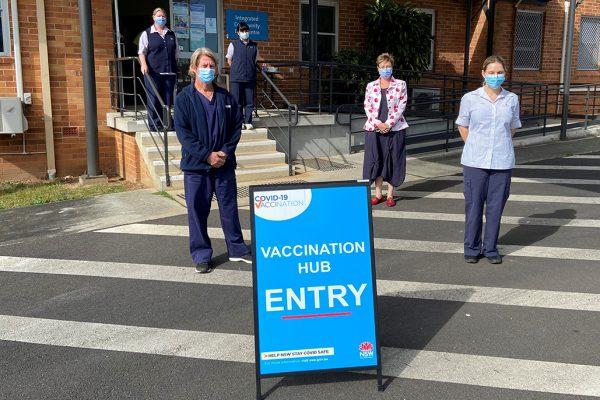 Nurses outside a vaccination centre