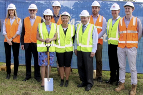 Parliamentarian and Board member with staff turning the first sod for the car park build