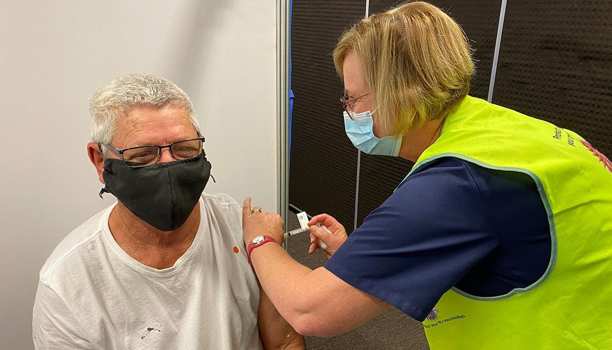 nurse vaccinating a man